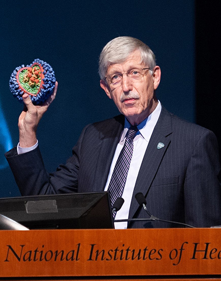 Francis Collins holding a flu virus model