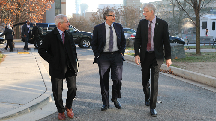Francis Collins walking with Bill Gates and Tony Fauci