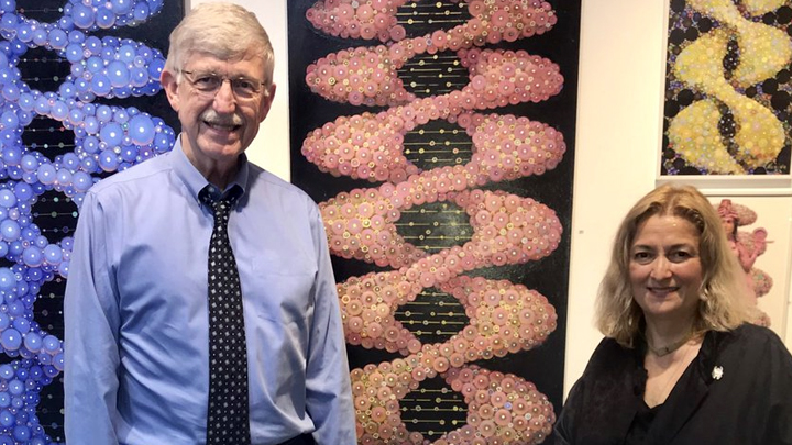 Dr. Francis Collins poses with the artist Nana Bagdavadzeand her work depicting DNA