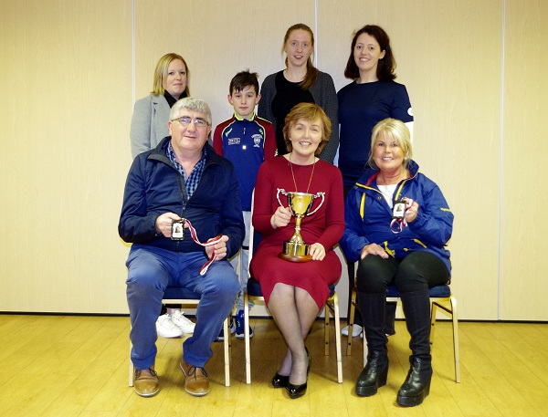 back row - Naomi Young (Parents Association) Cillian O'Brien (student) Karen Ryan (teacher) Joan Cummins (teacher & event organiser) Front - Sean Shanahan (sponsor) Kay Ryan (Principal of Scoil Naomh Cualan) Marie Shanahan (sponsor)