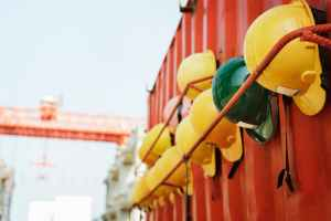 Hard hats hang up at a worksite