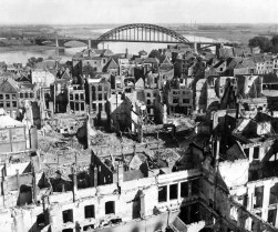 A panoramic view of the city of Nijmegen, Holland, and the Nijmegen Bridge over the Waal (Rhine) River in the background. The city was hit by German and Allied bombardment and shelling. September 28, 1944. Poznak. (Army) NARA FILE #: 111-SC-194568 WAR & CONFLICT BOOK #: 1067