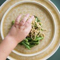 Makkelijk recept: spaghetti met sperziebonen, rucola en pistache dressing