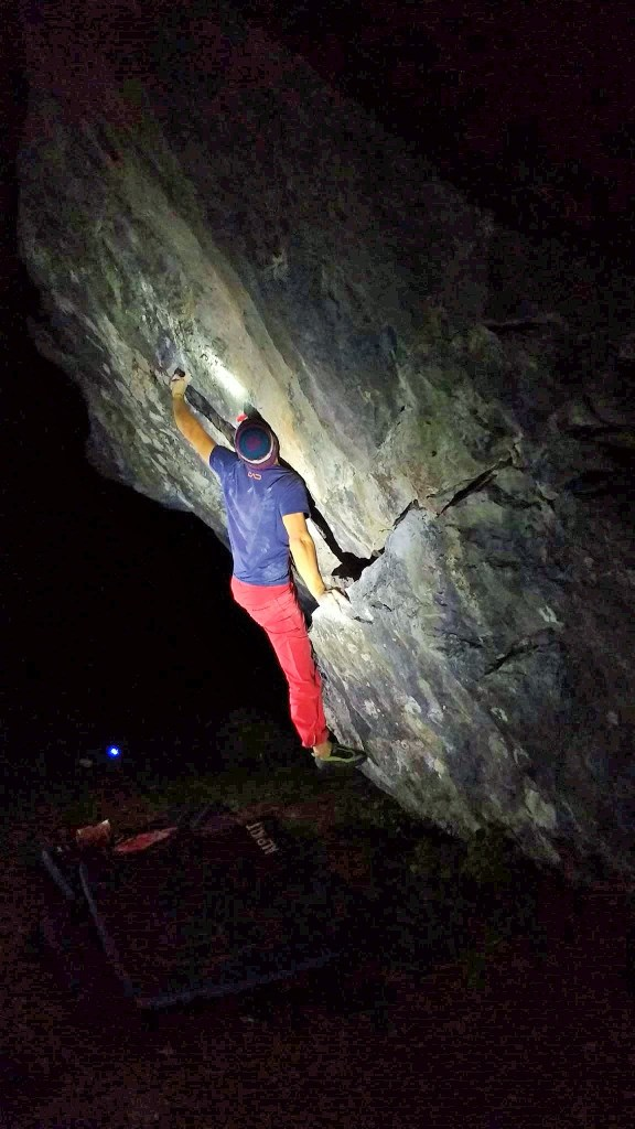 Night bouldering at Trowbarrow Quarry, Jame on Shallow Groove V11.