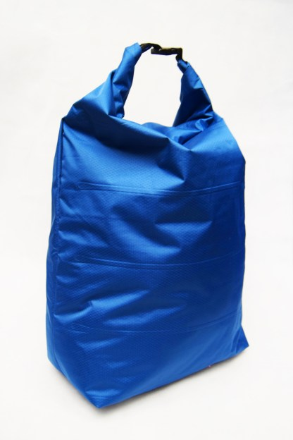 A blue roll top dry bag made using a repurposed sleeping mat