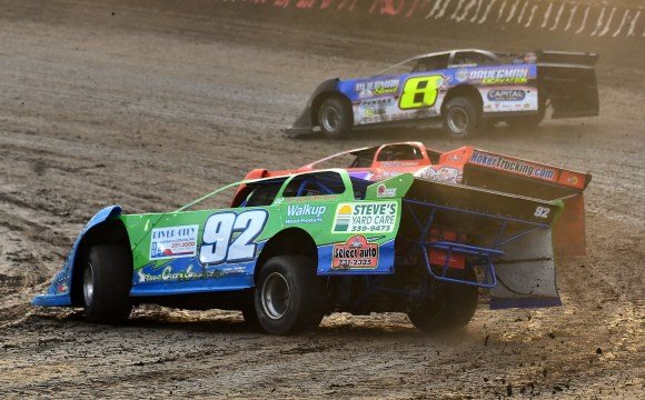 Photo ALT info: Jacob Brown in his green and blue number 92 Late Model slides around a corner as he battles against two other competitors at I-80 Speedway during the Silver Dollar Nationals in July 2020. Photo provided by Todd Boyd.