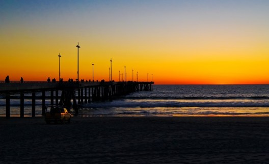 washington street pier washed with a golden sunset off Venice Beach