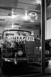 The hustler store reflected off a car dealership window on the sunset strip in california