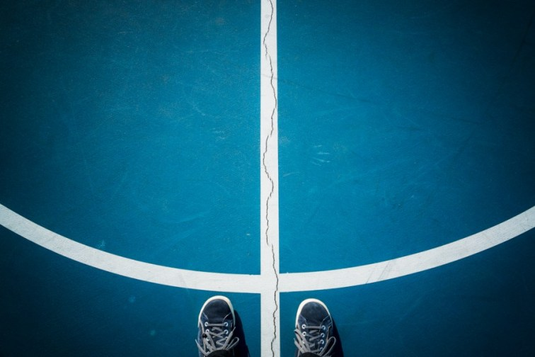 my blue suede shoes on a blue basketball court