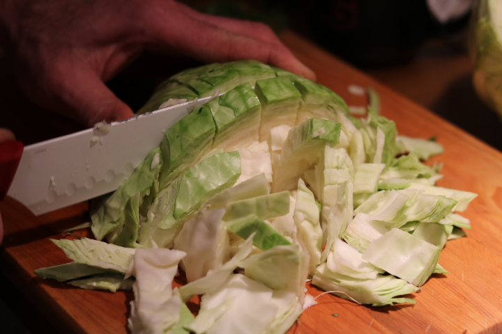 Healthy Raw Green Cabbage Ceramic Knife Prep Cut