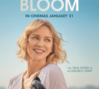 This image is the promotional movie poster. The title Penguin Bloom is in large font at the top. A blond middle-aged woman is smiling and looking out of the frame. She is wearing a white top and holding a black magpie bird. The background is a pale blue sky.