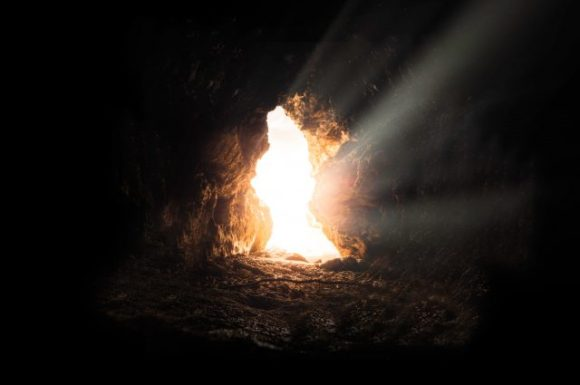 Light shines through a cave opening, reminiscent of when the stone was rolled away on the day of the resurrection of Christ.