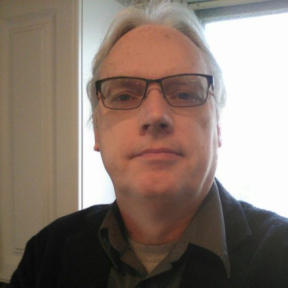 profile picture of Thomas Hentrich.  He is causasian and has grey hair.  He is wearing dark-framed glasses and is looking directly into the camera with a small smile.