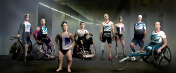 This image is of eight paralympians. They are posed in a way that is confident and strong.