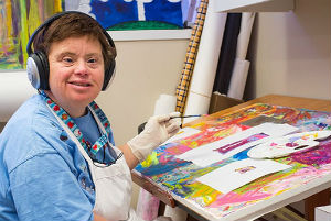 women with down syndrome painting at community center
