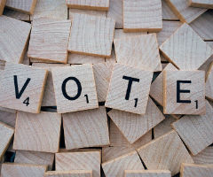 """The word, """"Vote"""" on Scrabble tiles"""