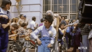 Still frame of Crip Camp movie showing a protest outside a building