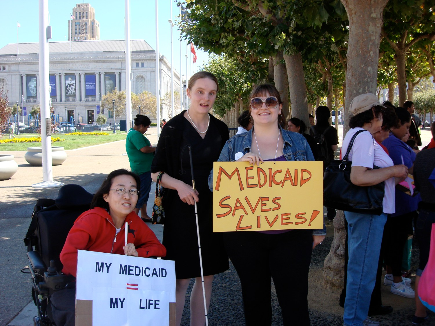 """Photo of three women at a protest about Medicaid in San Francisco holding signs saying, """"My Medicaid=My Life"""" and """"Medicaid Saves Lives."""""""