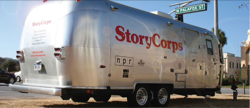 Image of a mobile booth in the shape of a metallic long trailer that is part of StoryCorps' Mobile Tour