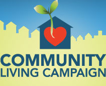Logo for the Community Living Campaign. In the background is the outline of a city's skyline. In the front is an image of a house with a heart inside. A plant is growing outside of the heart.