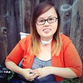 Asian American woman with blonde highlights. She is wearing glasses and is sitting in a wheelchair.