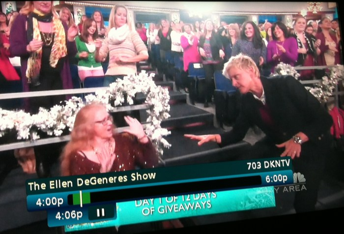 Screenshot from The Ellen Show where Ellen Degeneres is dancing with a person in a wheelchair.