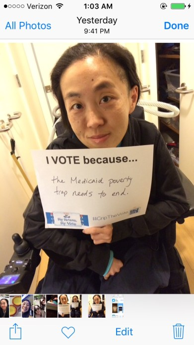 "Screenshot of an iPhone's Photo library with an image of an Asian American woman in a wheelchair holding a white piece of paper that says, ""I Vote because...the Medicaid poverty trap needs to end."""