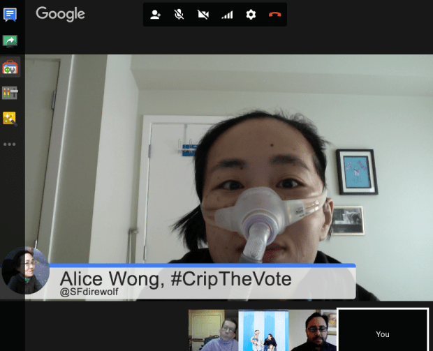 Screenshot of a Google hangout. An Asian-American woman with short black hair. She is wearing a mask around her nose with a tube. There is a horizontal panel below her that reads, Alice Wong, #CripTheVote @SFdirewolf