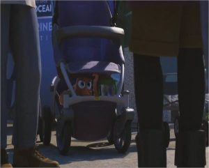 """An animated scene from the Pixar film """"Finding Dory."""" An image of a outdoor crowd with a baby stroller with an octopus and a sippy cup with a blue fish inside."""