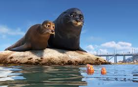"""An animated scene from the Pixar film """"Finding Dory."""" Two sea lions on a rock talking to two small clownfish."""