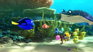 "An animated scene from the Pixar film ""Finding Dory."" A coral reef with a blue tang fish talking to several smaller sea creatures and a manta ray"