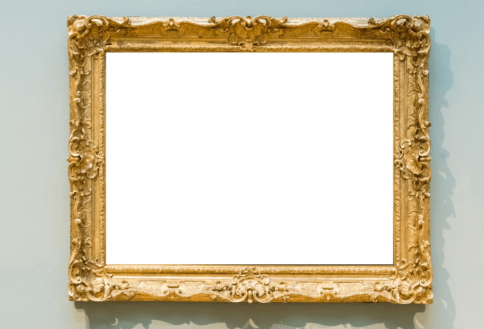 Ornate gold frame with a blank white canvas on a wall