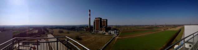 View of the coal-fired power plant, rail lines, and steam pipes from the viewing platform on the roof of the waste-to-energy facility. Author's photo.