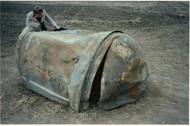 "The main propellant tank of the second stage of a Delta 2 launch vehicle landed near Georgetown, Texas, on January 22, 1997. This approximately 250-kg tank is primarily a stainless steel structure and survived reentry relatively intact. Photo Credit: NASA. From ""The Greening of Orbital Debris"" by Nicholas Johnson, NASA chief scientist for orbital debris at Johnson Space Center."