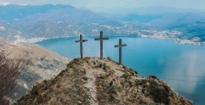 Three Crosses on a hill overlooking water