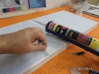 allowing the sealant to react with the paper