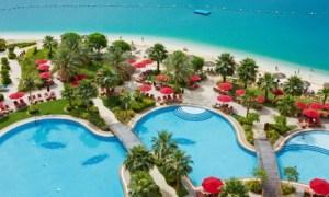 Pool & beach at Khalidiya Palace Rayhaan