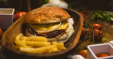 Burger with Fries and Soft Drink at Local House Restaurant