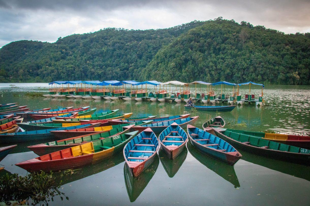 Colourful boats bob on Phewa Lake, Pokhara