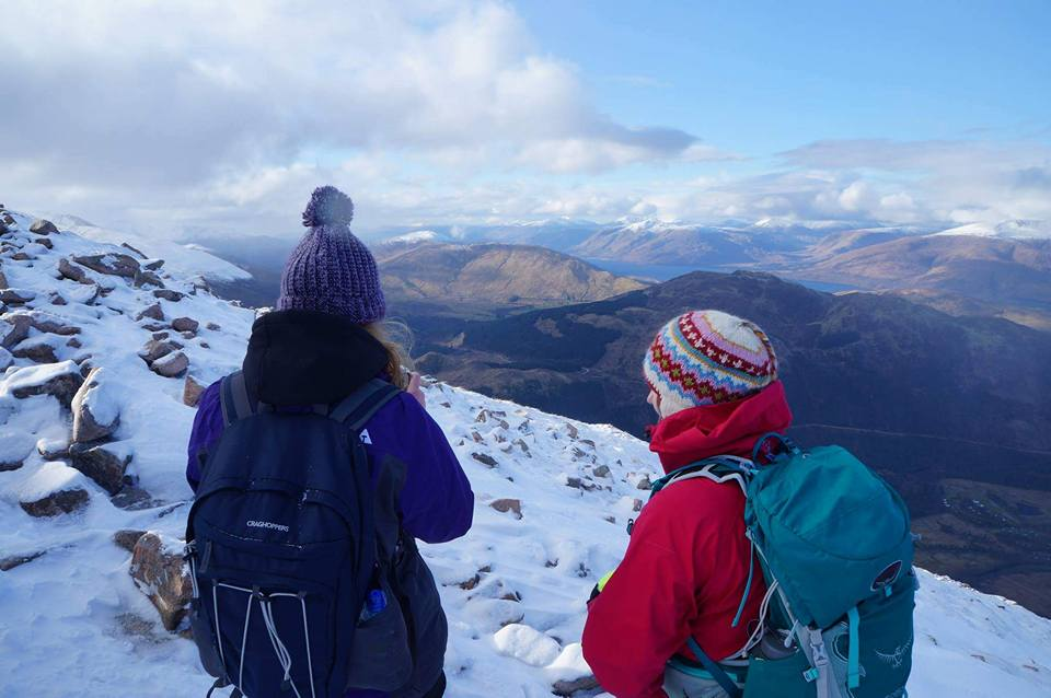 two hikers stand on top of ben nevis