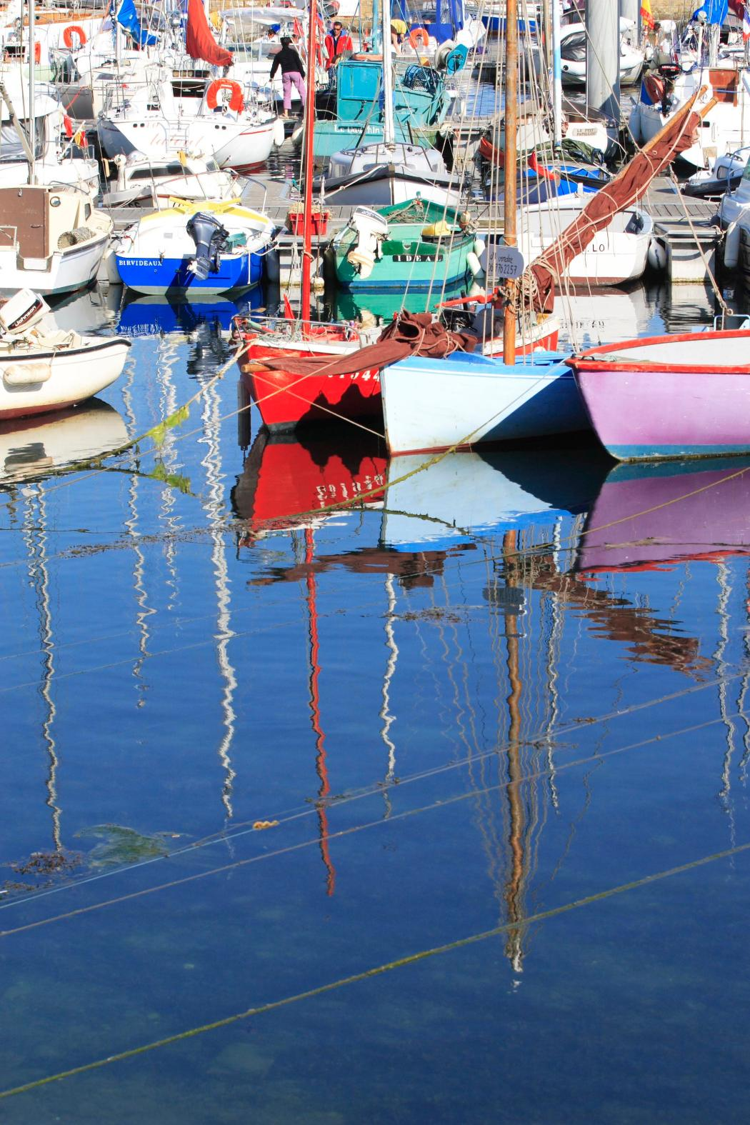 Reflections in the pontoon basin of Port Tudy, Groix's main harbor