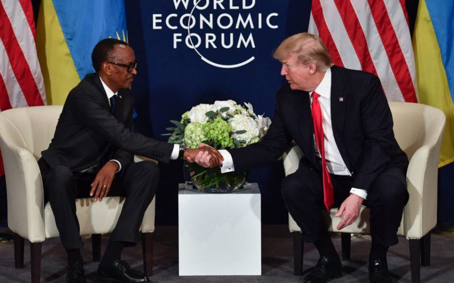 US President Donald Trump (R) shakes hands with Rwandan President President Paul Kagame during a bilateral meeting on the sideline of the annual meeting of the World Economic Forum (WEF) on January 26, 2018 in Davos, eastern Switzerland. / AFP PHOTO / Nicholas Kamm