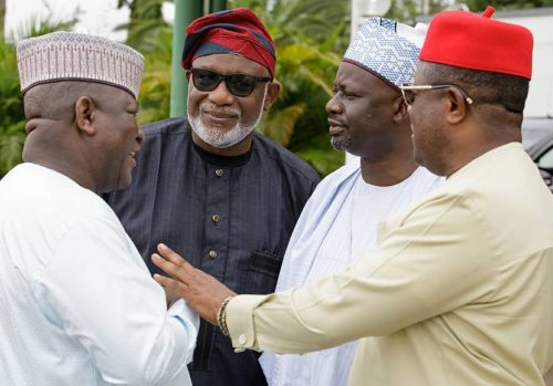 FILE: Governor Dave Umahi in red cap fraternising with APC