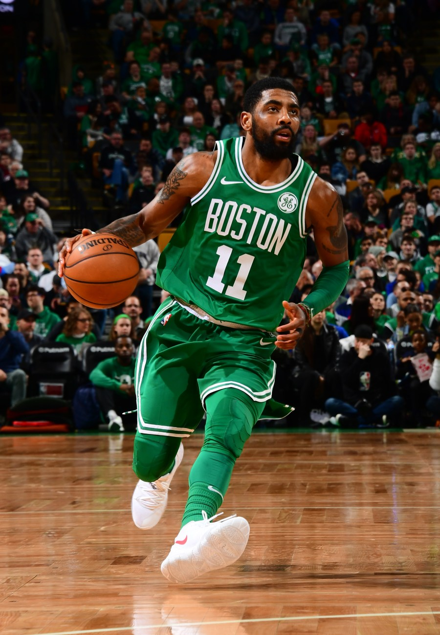 BOSTON, MA - MARCH 16: Kyrie Irving #11 of the Boston Celtics handles the ball against the Atlanta Hawks on March 16, 2019 at the TD Garden in Boston, Massachusetts.  NOTE TO USER: User expressly acknowledges and agrees that, by downloading and or using this photograph, User is consenting to the terms and conditions of the Getty Images License Agreement. Mandatory Copyright Notice: Copyright 2019 NBAE  (Photo by Scott Cunningham/NBAE via Getty Images)