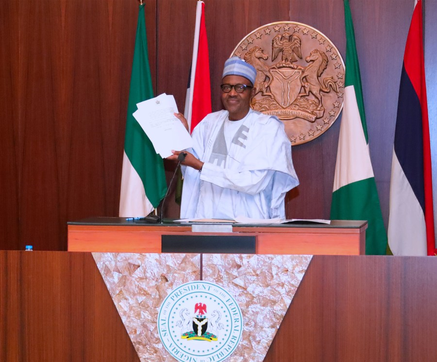 FILE PHOTO: President, Muhammadu Buhari has assented to the new minimum wage bill
