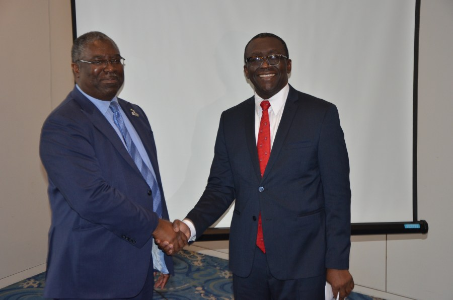 The Executive Chairman, FIRS Tunde Fowler in a handshake with Chairman of Technical Committee, Amb Adeyemi Dipeolu
