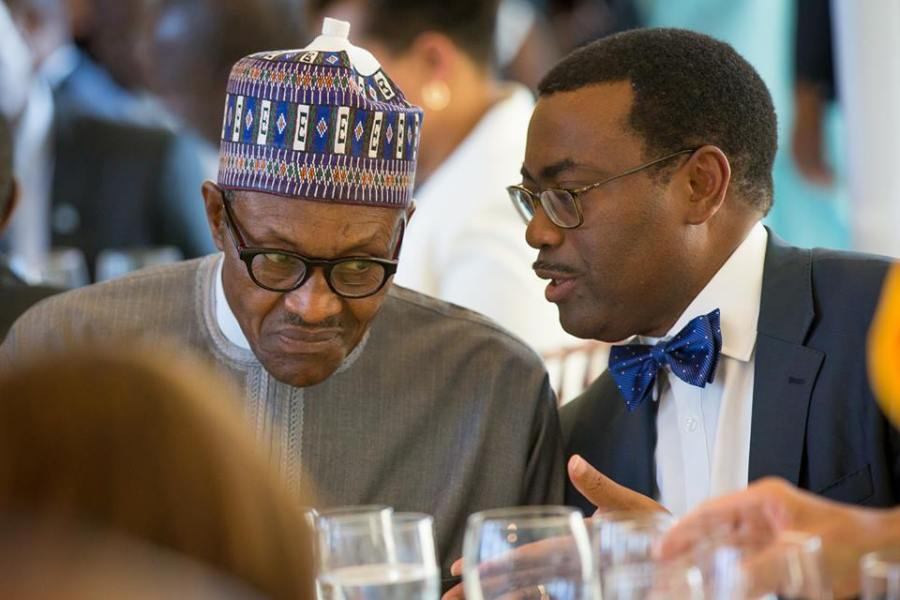 President of African Development Bank for former Agriculture Minister in Nigeria Akinwunmi Adesina and President of Nigeria, Muhammadu Buhari