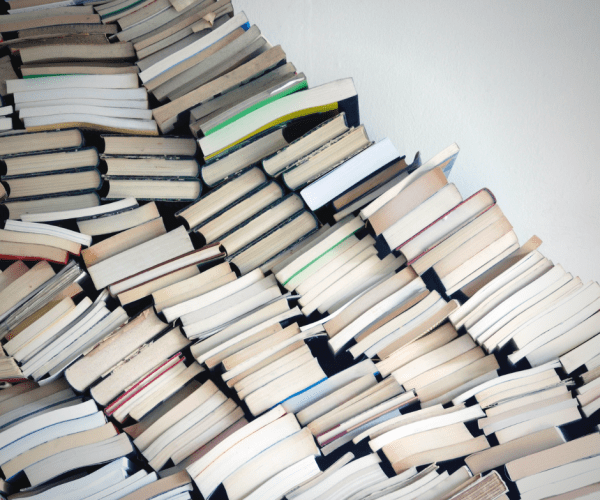 Piles of books needing to be organized. How to organize your books.