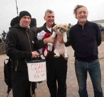 Doing their bit collecting for Azanum House at the Xmas swim Bundoran are Ken Page, Tracey Rogers Michael Breslin and Oscar the dog. Photo:philipmulliganphotography.com