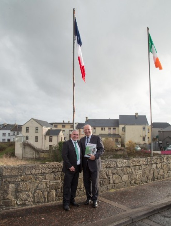 Tourism Officer Shane Smyth with the French Ambassador H.E. Jean-Pierre Thébault beneath the French tricolour which was flown on the bridge for the day to mark the occasion. Pic CMP Productions — with Ambassade de France en Irlande at Discover Bundoran.